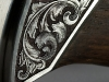 Damasteel knife engraving close-up