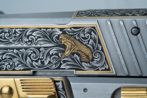 Close up of gold inlaid cobra on Sig Sauer slide