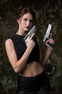 Sexy model holding Sig Sauer P226 and X-Five
